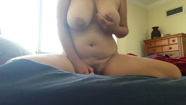 Big tit MILF rubs her pussy with vibrator
