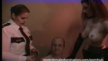 Policewoman and a dominatrix team up to interrogate a criminal