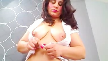 Sexy MILF with large breasts teasing on webcam